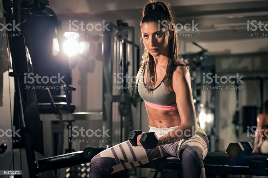 Sporty woman workout with dumbbell stock photo