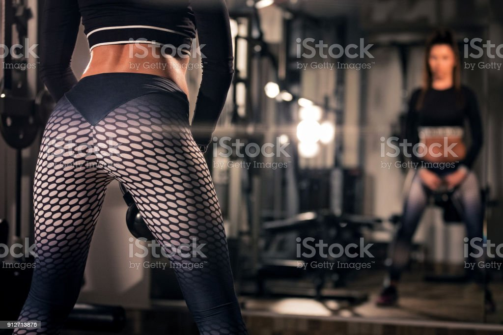 Sporty woman workout with kettlebell stock photo