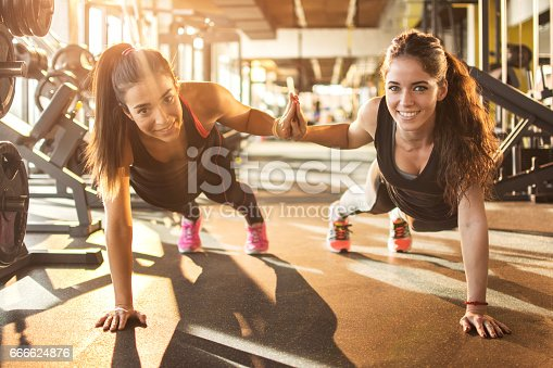 istock Sporty women working out together at gym. 666624876