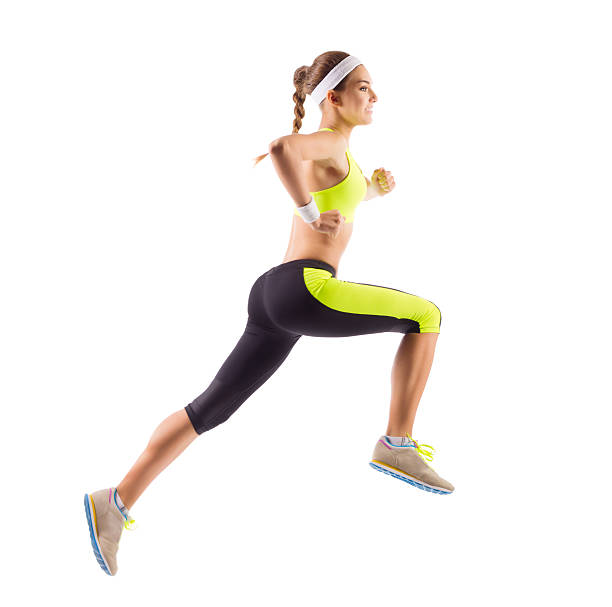 Sporty young running girl stock photo