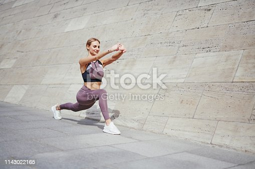 istock sporty young woman is running outdoor in the city 1143022165