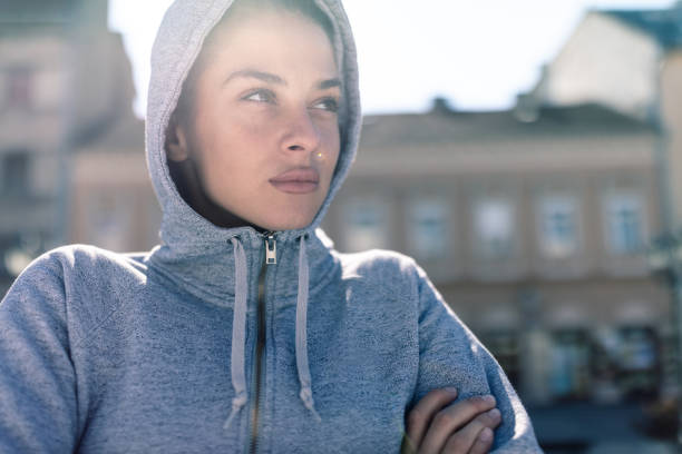 Sporty young woman Portrait of a sporty young woman preparing for a morning training session tuff stock pictures, royalty-free photos & images