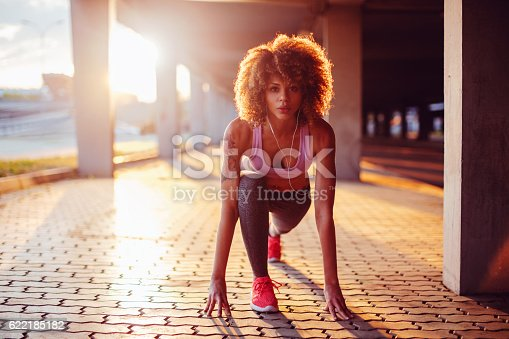 Close up of a young woman getting ready to run