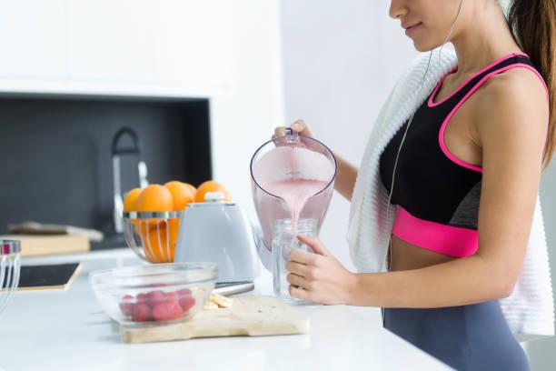 Sporty young woman serving strawberry smoothie in a glass jar in the picture id1127806175?b=1&k=6&m=1127806175&s=612x612&w=0&h=fmwye7kh wy z8xfjfke1akn dum3oxfc17gkfhfdjo=