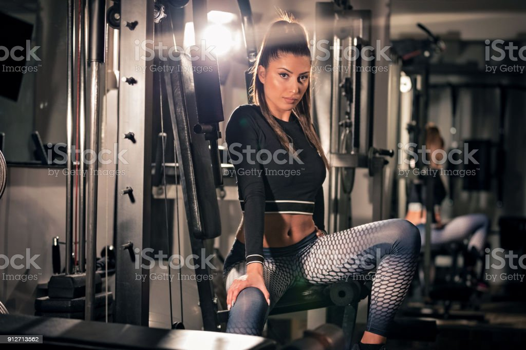 Sporty young woman workout on an exercising machine stock photo