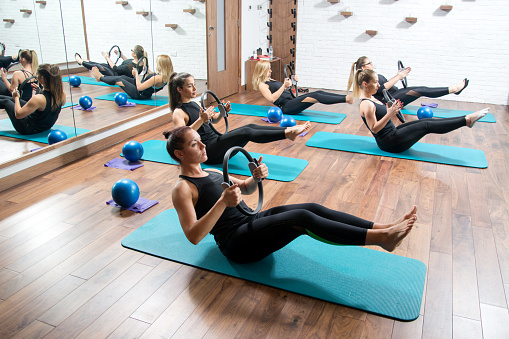 Sporty Young Women With Exercising Rings In Fitness Studio Stock Photo - Download Image Now