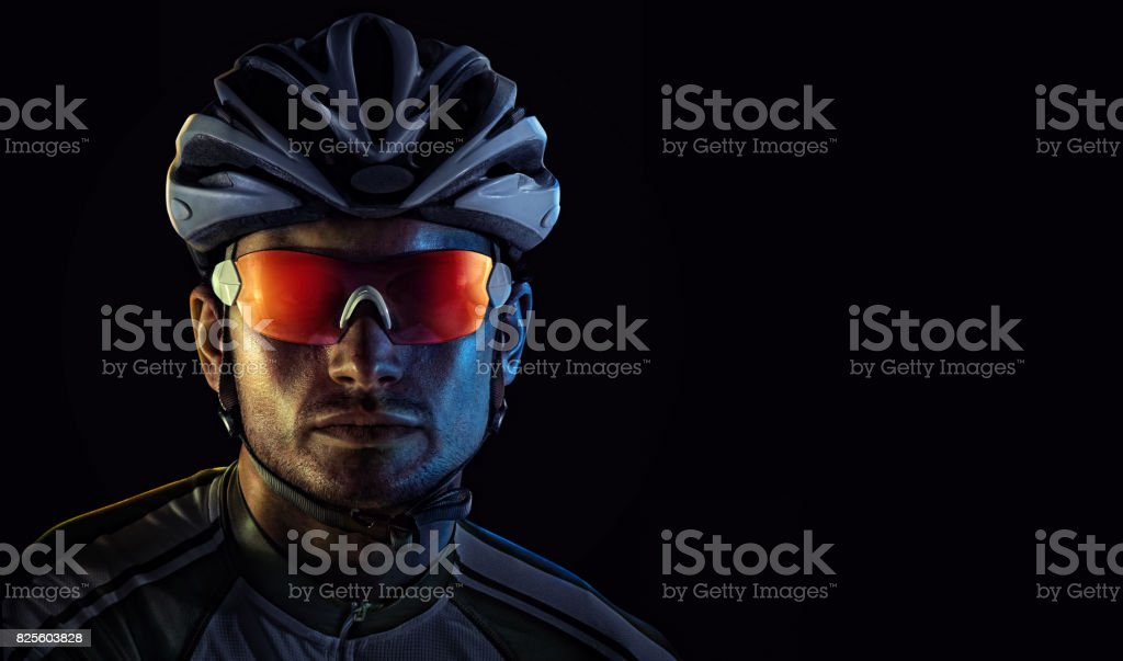 Spost background with copyspace. Cyclist. Dramaticcolorful close-up portrait. stock photo