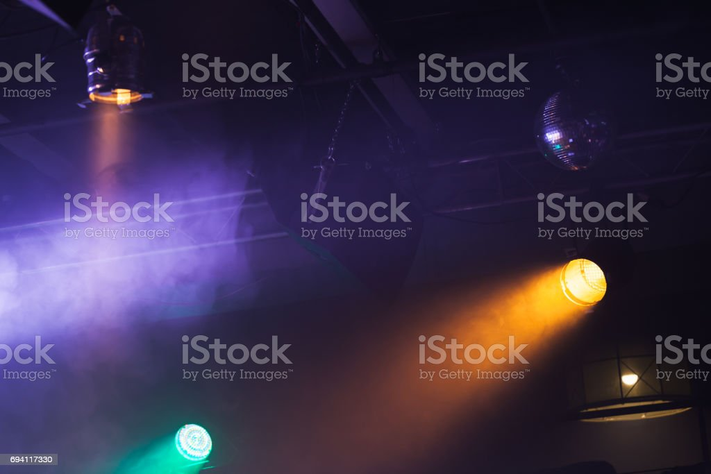 Spot lights over dark background, rock music concert stage...