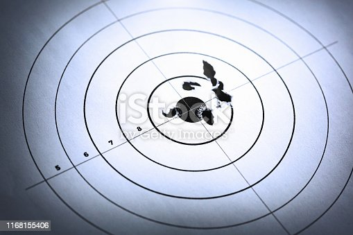 High angle look at a sports shooting target with a close grouping around the bull's eye.
