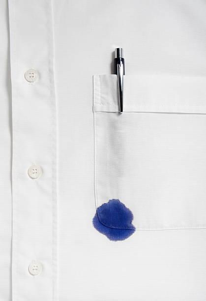 Spot of blue ink from a pen on a white shirt stock photo