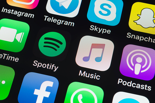 Spotify, Apple Music, Podcasts and other phone Apps on iPhone screen