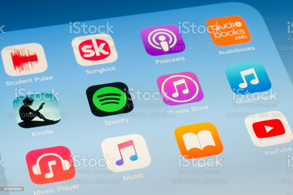 Spotify, iTunes and other music streaming Apps on iPad screen stock photo