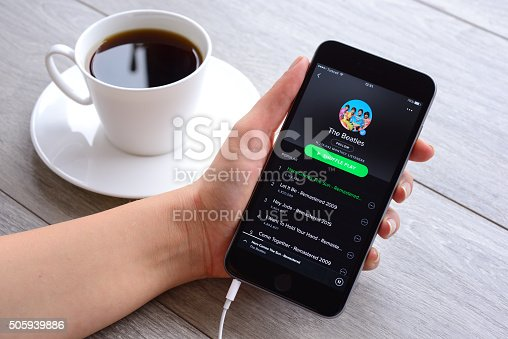İstanbul, Turkey - January 16, 2016: Woman hands holding an Apple iPhone 6 Plus displaying Spotify application.  iPhone, produced by Apple Computer, Inc.