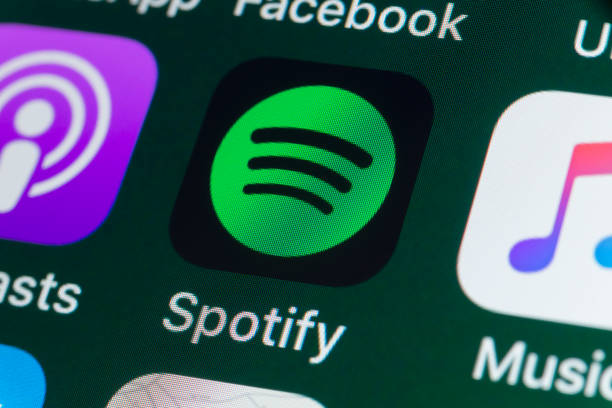 Spotify, Podcasts, Music and other Apps on iPhone screen stock photo