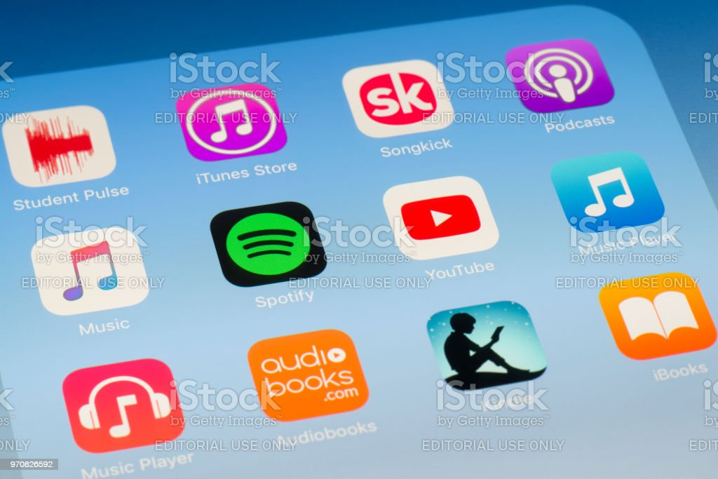 Spotify, YouTube and other music streaming Apps on iPad screen stock photo