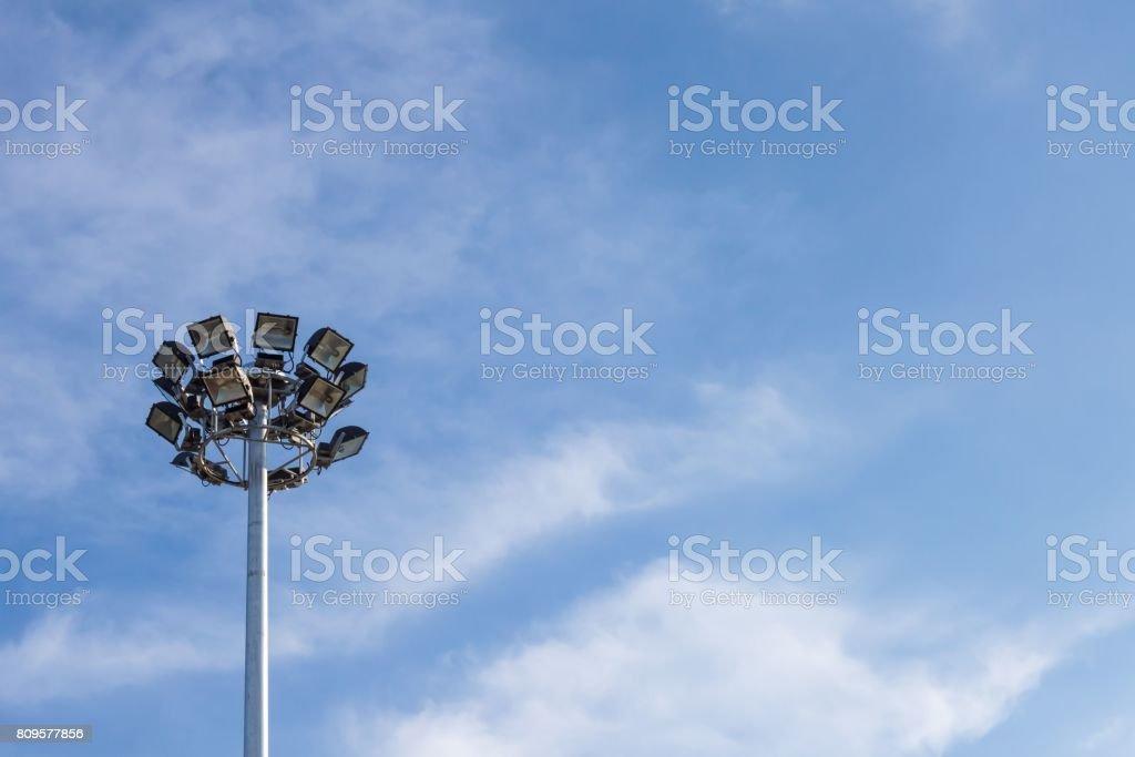 Spotlight and the sky. stock photo