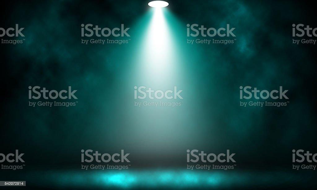 Spotlight blue effect on smoke stage background. stock photo