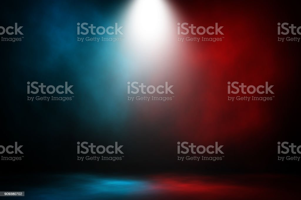 Spotlight fight and match red and blue smoke background. stock photo