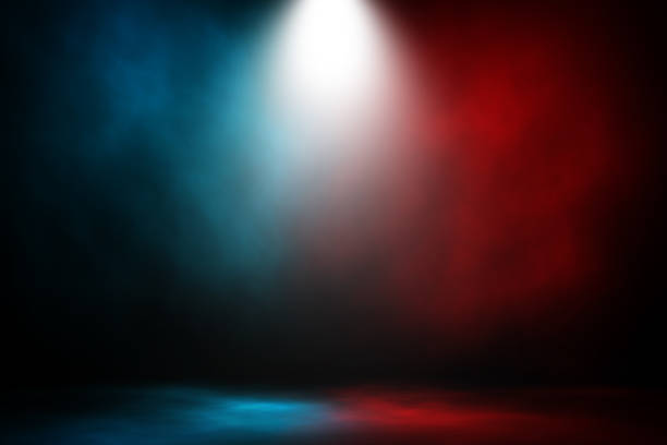 spotlight fight and match red and blue smoke background. - battle stock photos and pictures