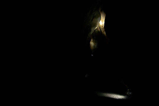 spotlight in black cavern mysterious spotlights in dark, black cavern arcane stock pictures, royalty-free photos & images