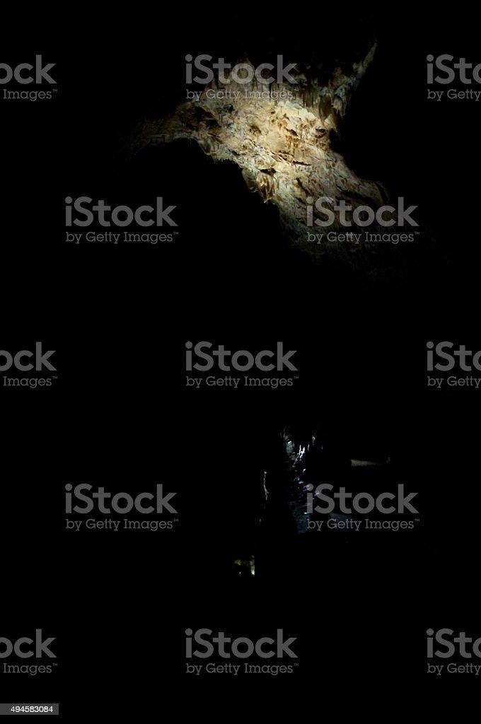 spotlight in black cavern stock photo