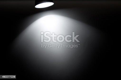 Spotlight on a black background (100% real photo)