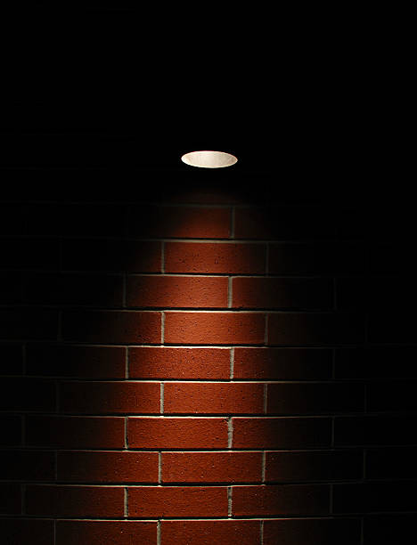 Spotlight on a red brick wall stok fotoğrafı