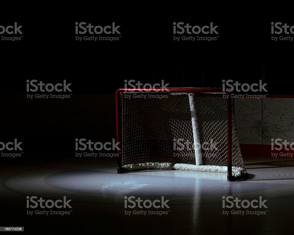 Spotlight on an empty hockey net royalty-free stock photo