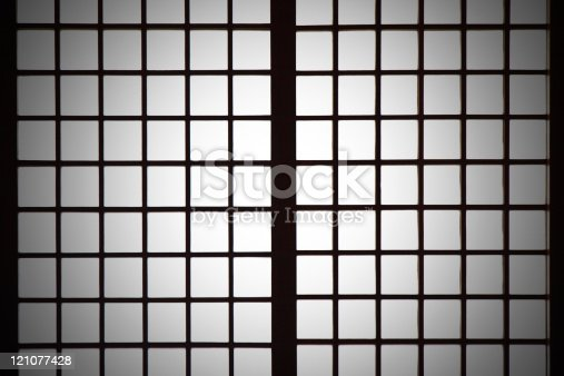 Backlit Japanese style paper screen partition (Shoji) with vignetting.