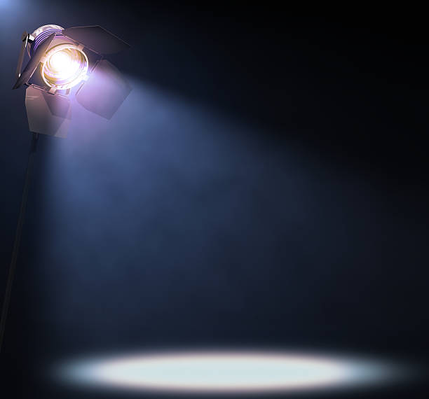 Spotlight The lights illuminate the area where someone or something important is in the spotlight. His text or image in the center of the lights. stage light stock pictures, royalty-free photos & images
