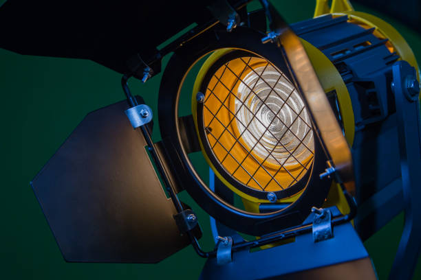 A spotlight with a Fresnel lens and a halogen lamp. Equipment for photographing and filming in the interior. Close-up