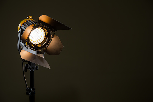 Spotlight with directional light with a Fresnel lens, halogen lamp and protective shutters.