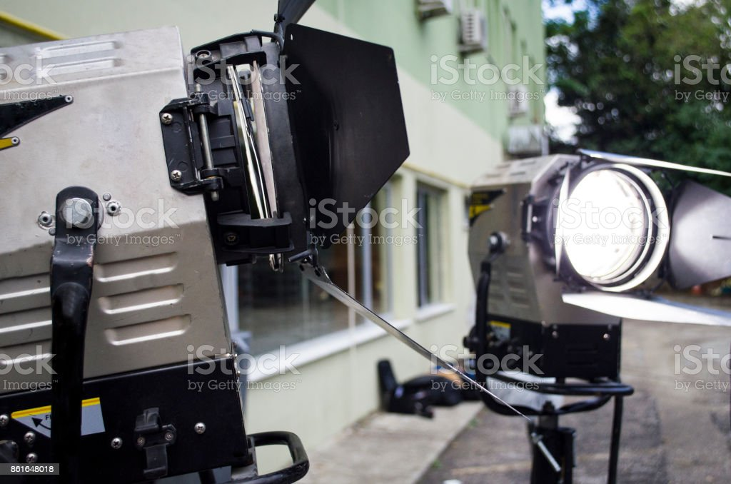 spotlight with directional light with a fresnel lens halogen lamp and protective shutters stock photo
