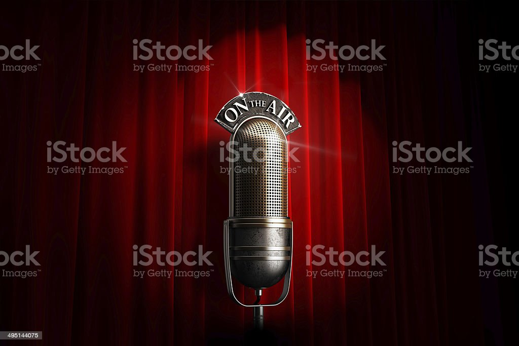 Spotlighted vintage microphone stock photo