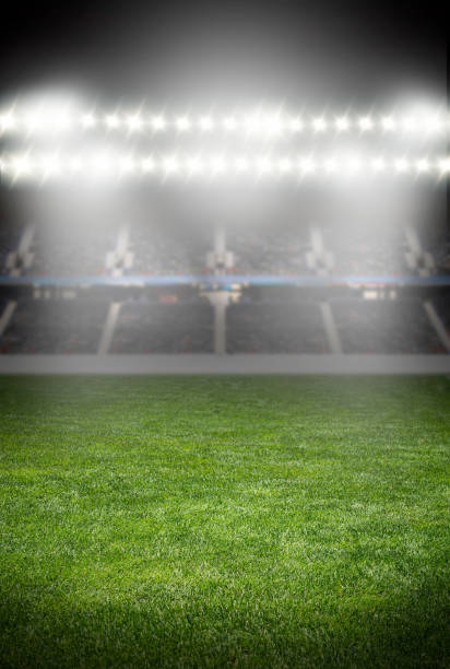 spotlights at the soccer arena - sports championship stock photos and pictures