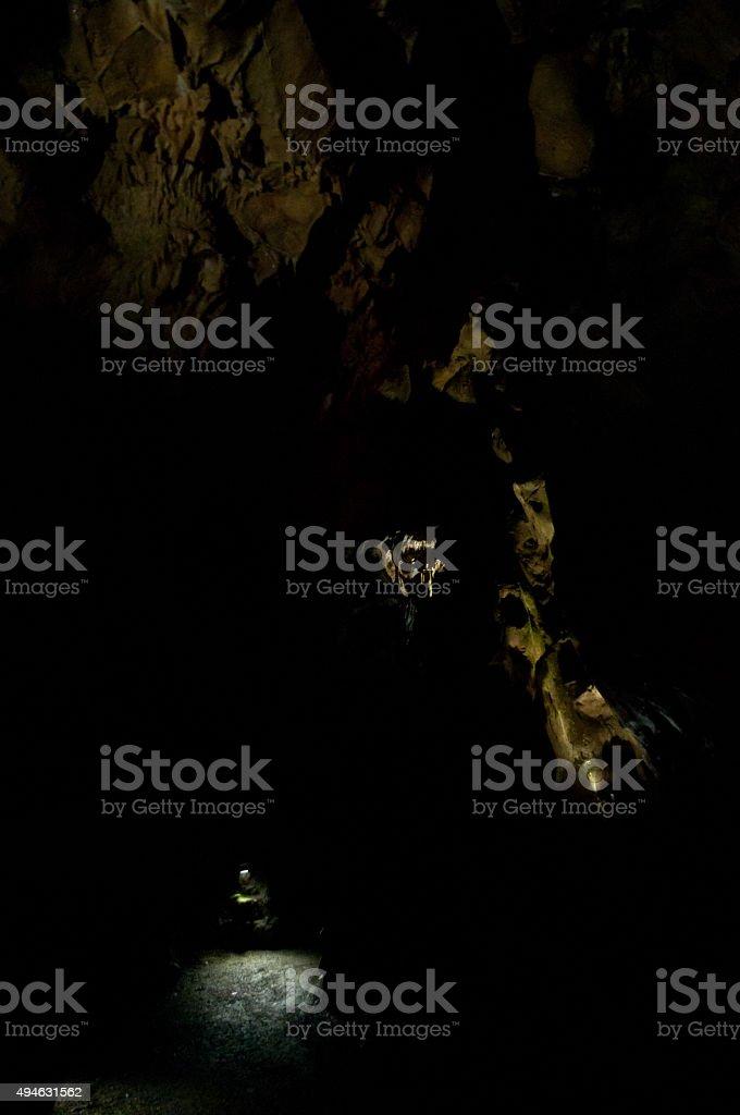 spotlights in black cavern stock photo