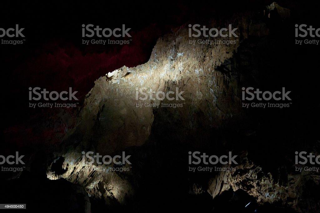 spotlights in dark cavern stock photo