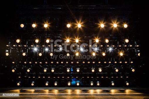 istock Spotlights & lighting equipment for the theater. Yellow light 825988986