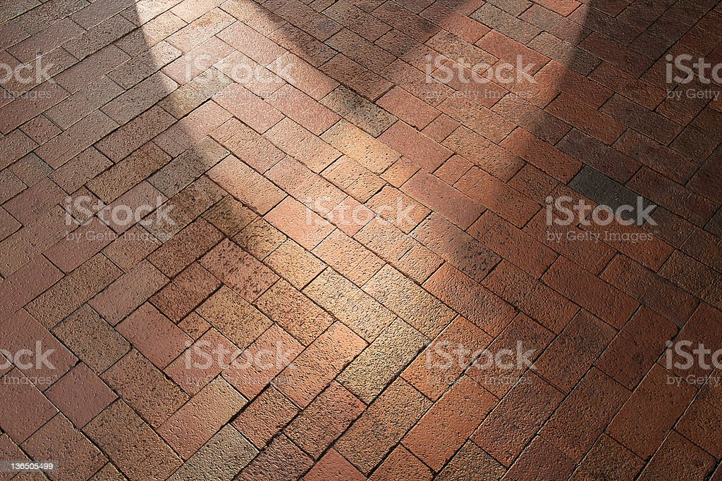Spotlights on Diagonal Red Brick Pavement stock photo