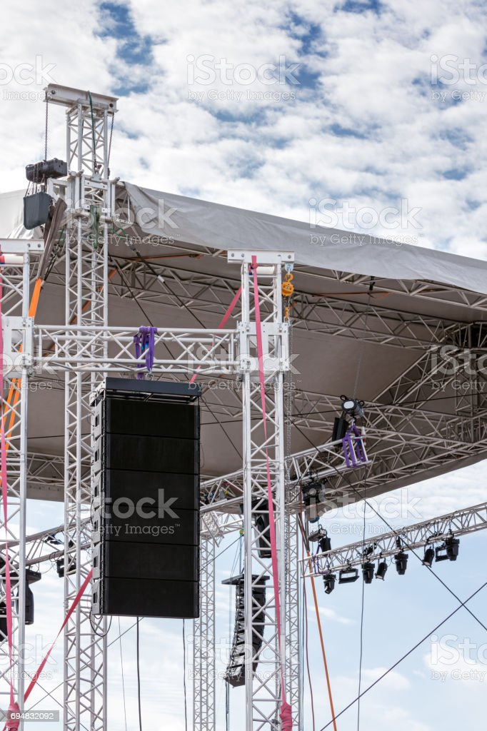 spotlights system mounted under roof of outdoor stage before music...
