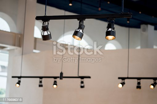 Spotlights under the ceiling on the wall decoration in cafe