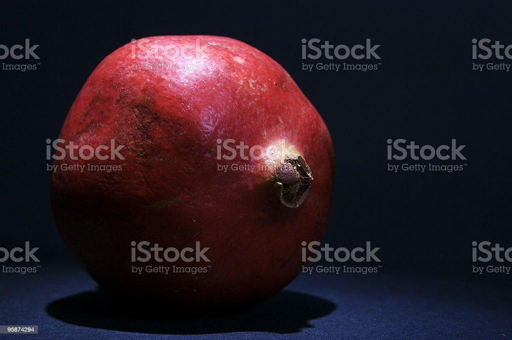 Spotlit Pomegranate royalty-free stock photo