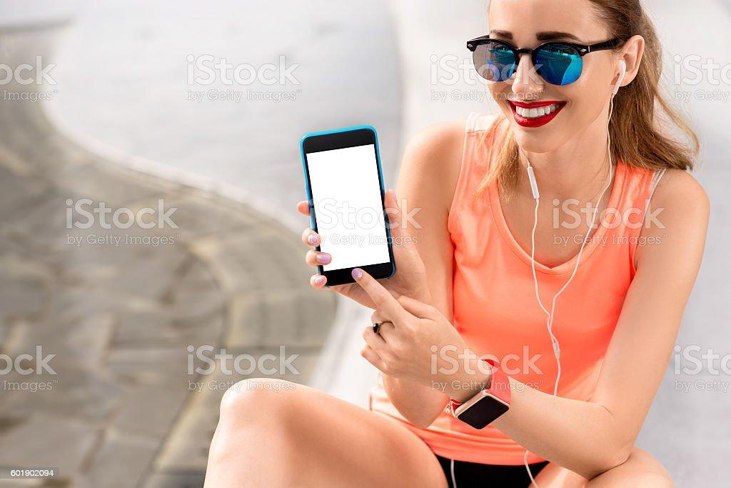 Spots woman showing phone screen stock photo