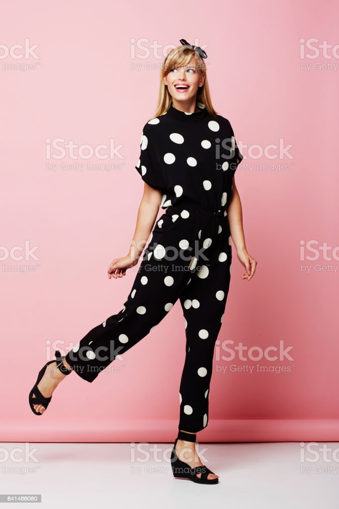 Spotted jumpsuit girl stock photo