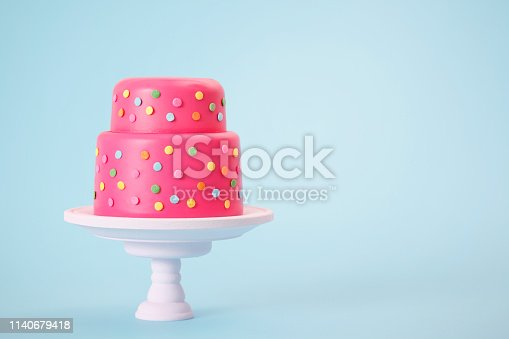 Cheerful spotted pink cake with copy space.
