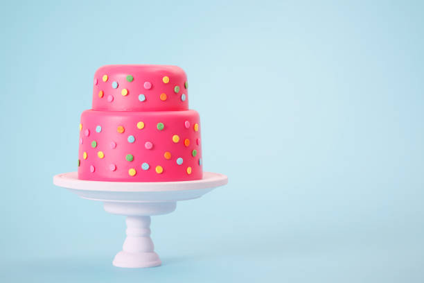 Spotted Pink Cake Cheerful spotted pink cake with copy space. cake stock pictures, royalty-free photos & images