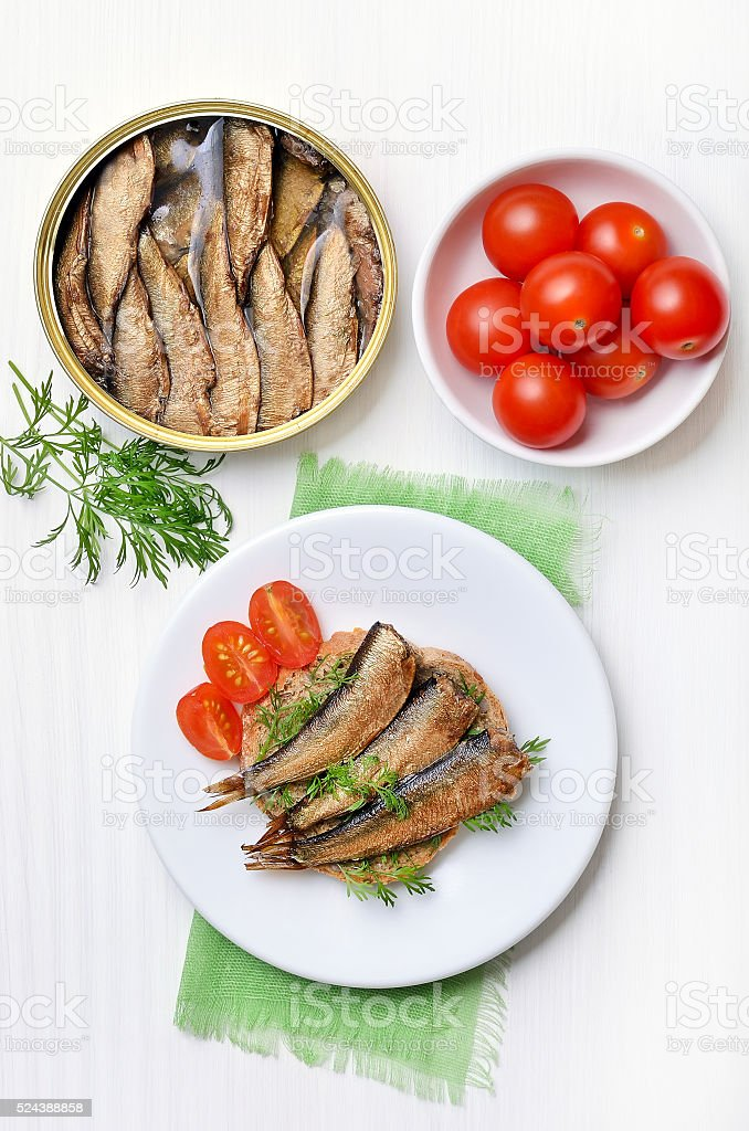 Sprats sandwich and tomatoes stock photo