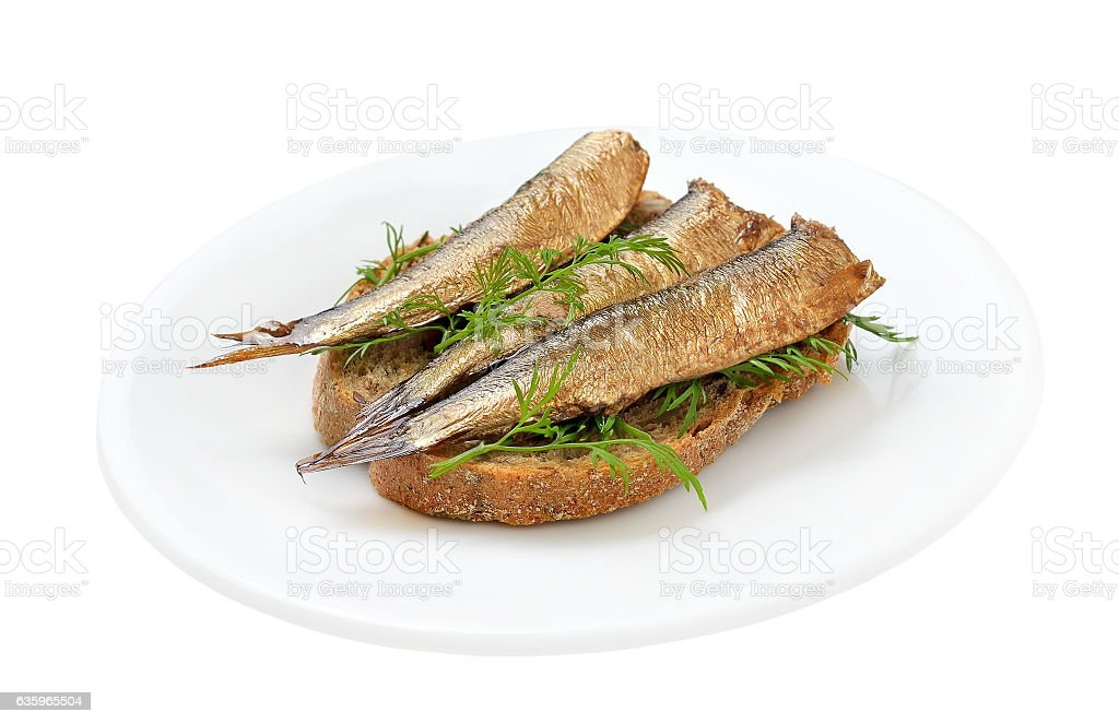 Sprats sandwiches on a plate stock photo