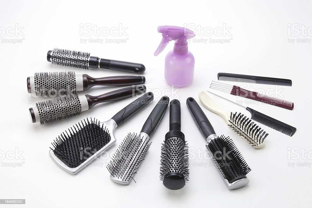 Spray Bottle and Spread of Brushes stock photo