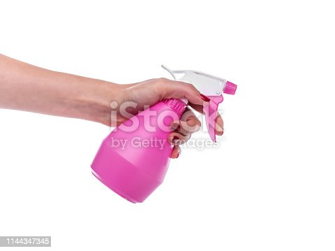 istock Spray bottle in female hand on white background. 1144347345